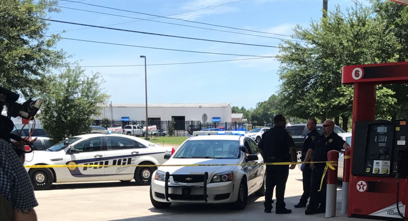 Mobile Police Investigates a Homicide at the Texaco Gas
