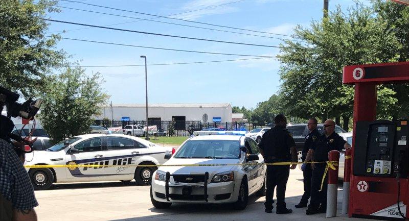 Mobile Police Investigates a Homicide at the Texaco Gas