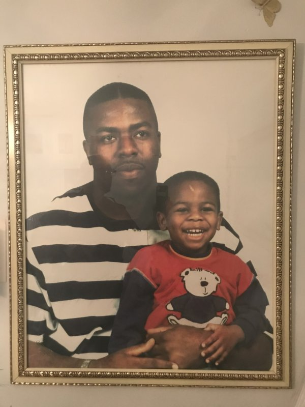 Photo of cold case victim, Marcel Chandler, holding his 4-year-old son