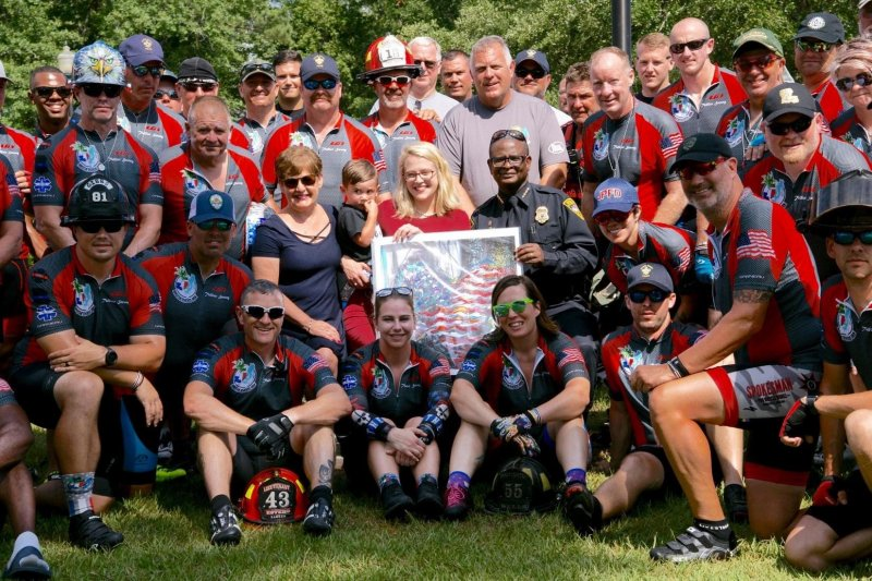 The Gulf Coast Brotherhood Riders take a group picture with Erin Billa during their 2019 ride honoring Fallen Officer Justin Billa and other fallen first responders.